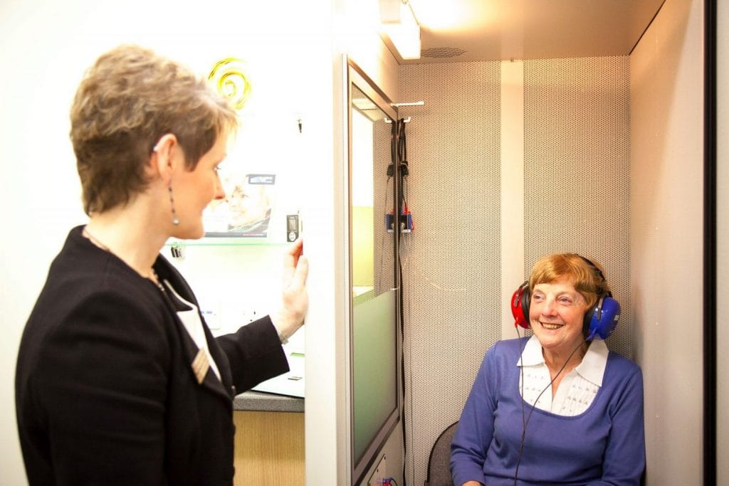 Karen Finch, MD of The Hearing Care Centre getting a patient ready for a hearing assessment